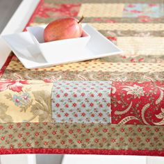 "Highlight 5"" charm squares between 2-1⁄2""-wide fabric strips in a quilt-as-you-go table runner to make home decor in no time."