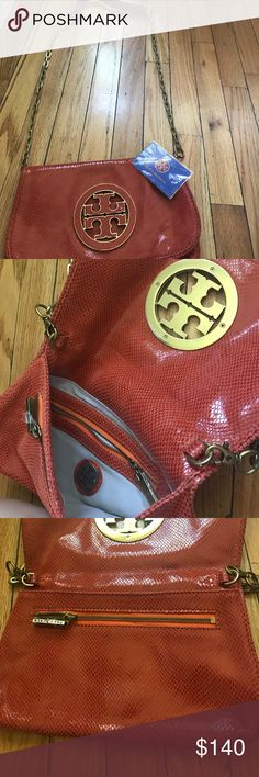 Tory Burch Bag (Orange Italian Leather) Found this nag in my garage looks new not sure if its real or fake Tory Burch Bags Clutches & Wristlets