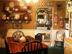 Country Cozy...I like the wall color, and the shelf display.