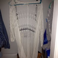 """Long white cardigan Covers your butt, in great condition, I'm 5""""8 so I have long arms and therefore the sleeves were shorter on me, but I let my mom borrow it she's like 5""""5 and the sleeves were fine in her American Eagle Outfitters Sweaters Cardigans"""