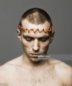 Stock Photo : young man with red wire around his head