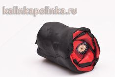Poppy flower cane tutorial.  The site's not in English, but the pictures are good.  Polymer clay cane.