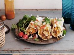 Tacos continue to surge in popularity and it's easy to see why –– the small tortilla bundles are filled with a variety of meat, seafood and vegetables cooked in savory sauces and are piled with bright, spicy toppings. Here are some of Cooking Channel's best.