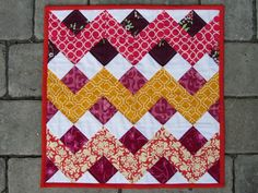 quilt card inspiration from Trio Stitch Studio ... lots of little squares form chevron patterns ... pull out a little square punch to make even sized squares from scrap papers!!
