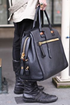 WANT. this bag is masculine, sophisticated, and looks like it can handle wear and tear.