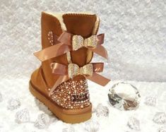 Custom Bling'd Women's UGG Bailey Bow Boots - Chestnut (more colors available, please contact us for custom orders) ***INCLUDES both heels bling'd and gold rhinestone bow charms added. These custom bo Outfits Ugg Boots, Ugg Style Boots, Bow Boots, Ankle Boots, Ugg Shoes, Work Outfits, High Boots, Black Boots, Cowboy Boots