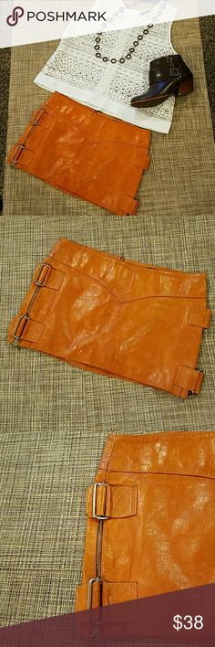 """Boutique Leather Skirt I worn this one a while ago. It is real leather with a sateen linen, metal  bucles at both sides. Being real leather, is has some weight.  Gorgeous camel color with some variations of it because of nature of the leather. Very gently worn. Length 11"""",waist 15"""" Pitanga  Skirts"""