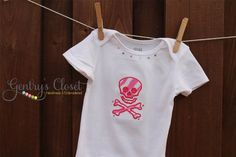 Baby Girl Onesie or Shirt - Pink Skull and Crossbones with Bling - Embroidered infant and toddler bodysuit and clothes. Handmade. via Etsy.