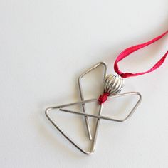 Tutorial: Make this simple elegant angel from a butterfly paperclip, a bead and some ribbon.