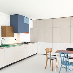An unsightly cooker hood is turned into a bright, boxy work of art in this loft apartment located in a converted school in Antwerp, Belgium. The cabinetry is the work of Dries Otten (driesotten.be), a designer with a love of combining simple lines and playful colour Color Blocking
