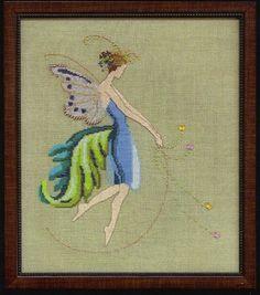 Nora Corbett Rhythm - Cross Stitch Pattern. From the Muse Collection. Model stitched on 32 Ct./16 Ct. Beach Walk linen or Aida with DMC floss, Kreinik #4 Braid,