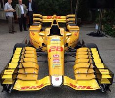 STRANGE MULTIPLE FRONT AIRFOILS IN COOL YELLOW FORMULA ONE RACER!