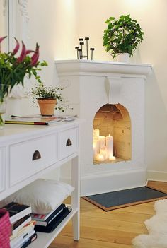 corner faux fireplace with candles