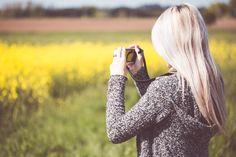 Girl Taking a Photo in Nature Free Stock Photo Download   picjumbo