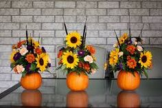 Pumpkin Flower Arrangement {Thanksgiving Centrepiece} Pumpkin Flower Vase — very detailed instructions are provided by Life At Cloverhill… abig help to those of us not comfortable with flower arranging. Pumpkin Arrangements, Fall Floral Arrangements, Flower Arrangement Designs, Pumpkin Centerpieces, Thanksgiving Centerpieces, Centerpiece Ideas, Halloween Flower Arrangements, Sunflower Arrangements, Vase Ideas