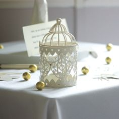 Recreate this pretty Christmas lighting by adding string of soft lights to Vintage Design Bird Cage Tealight Holder - Cream Wedding Table Themes, Vintage Wedding Theme, Wedding Decorations, Wedding Ideas, Wedding Stuff, Dream Wedding, Sleeping Beauty Wedding, Small Bird Cage, Florist Supplies