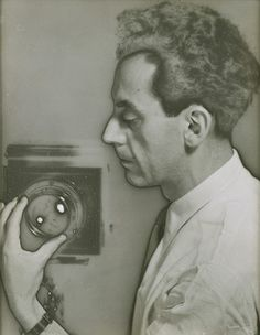 "Man Ray Portraits: Man Ray (1890-1976): Untitled (Self-Portrait with Camera), 1930 Man Ray / He was an American artist who described as a modernist, he was a significant contributor to both the Dada and Surrealist movements; although his ties to each were informal. ay is also noted for his work with photograms, with the artist coining the term ""Rayographs"" in reference to himself. (1890-1976)"