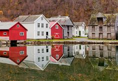 A lake in Laerdal reflects some of the old Norwegian homes in the village.