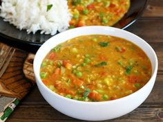 MIXED VEGETABLE DAL Recipe with toor dal, moong dal, urad dal, onions, garlic cloves, green chilies, ginger, cashew nuts, bay leaf, ground turmeric, cumin seed, red chile powder, garam masala, masala, broccoli florets, carrots, capsicum, frozen peas, cilantro leaves, salt, vegetable oil