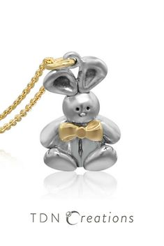 Are you looking for a sterling silver and gold charm necklace?  Here's a super cute rabbit pendant for the young and the young at heart! How can you resist the cuteness of this charming bunny?