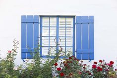 Bold blue shutters and colorful flowers add a touch of color to the La Quinta Resort's architecture.