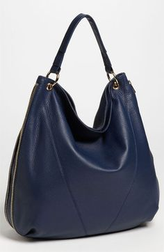 Elegantly simple construction lends timeless appeal to a nappa leather hobo fashioned with a zip-around gusset that expands for a bit of extra room.
