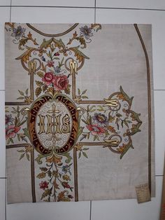 http://www.ebay.com/itm/Antique-French-Vestment-Chasuble-Floral-IHS-Embroidered-Panel-1930s-/272594358795?hash=item3f77e3d20b:g:~B0AAOSwCU1YzGCl