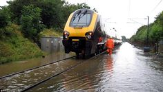 Flooded railway line near Dalton, North Yorkshire, which is preventing preventing the running of East Coast services between London and Scotland