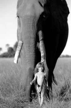 A french girl named Tippie Degre, called the real life Mowgli. :) A beautiful picture.