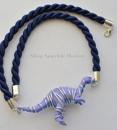 Silver wire wrapped lilac Velociraptor with navy blue cord created by ShopSparkleMotion on Etsy. Diy Jewlry, Velociraptor Dinosaur, Dinosaur Crafts, Handmade Jewelry, Unique Jewelry, Wire Wrapped Necklace, Crystal Collection, Wire Wrapping, Lilac