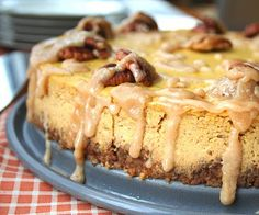 Pumpkin Bourbon Cheesecake with Spiced Pecan Crust by @Carolyn Ketchum.  Hello, gorgeous!