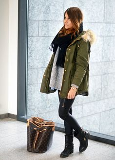 winter outfit louis vuitton black booties black pants grey sweater black scarf green parka faux fur