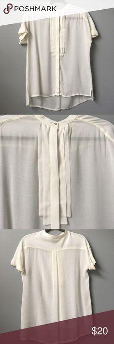 H&M off white blouse Off-white button down short sleeve blouse from H&M. Has one gold button at the top and white buttons with detail in front.  Size 2, but would also fit size 4. Worn once. H&M Tops Blouses