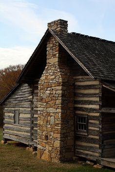 stone chimney, cedar roof, rustic love
