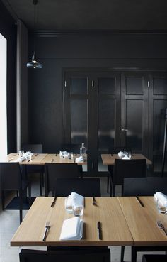 moody black conference room - charcoal felt behind molding