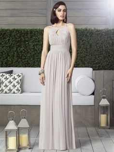Dessy Style 2906 is a Full length Lux Chiffon dress, with draped bodice and modified halter neckline. Cut out detail at bodice front and back. Shirred inset midriff and shirred skirt. Please also visit www.Dessy.com to see this dress in all colors.