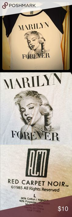 NWOT Marilyn Monroe vintage style T NWOT Marilyn Monroe vintage style Tee. Very short sleeves on this tee. It is a very light gray and black but the colors make it look white and black. All of my items come from a smoke free home. I love to do bundles :-) red carpet noir Tops Muscle Tees