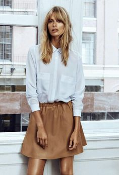 Blonde hair matches the brown skirt. Scandinavian style