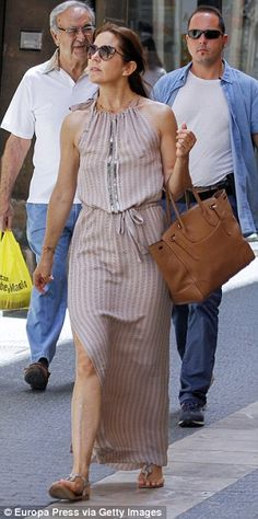 City chic: Mary wore a soft pink maxi dress with a thigh-high split for a shopping trip in Spain