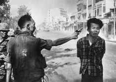 South Vietnam National Police Chief Nguyen Ngoc Loan executes suspected Viet Cong member Nguyen Van Lem, on the second day of the Tet Offensive during the Vietnam War. Photographer: Eddie Adams, 1968