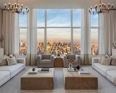 Gorgeous NYC white and beige living room decor with elegant beige sofas and armchairs, contemporary style beige living room decor, penthouse decor, high rise living room decor
