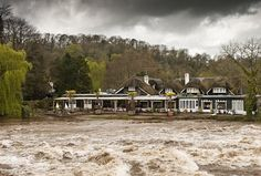 02/05/2012 Storm clouds loom overhead as the River Exe bursts its banks at The Fisherman's Cot, in Bickleigh-on-Exe