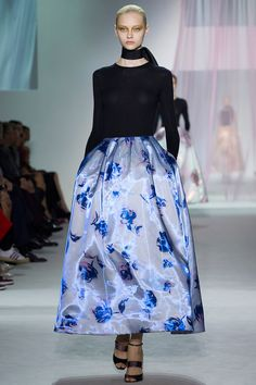 Raf Simons's standout debut Dior Haute Couture collection was followed by a resplendent, transcendent showing of ready to wear: Bar jackets reworked as flouncy coatdresses; ethereal, Op-art evening dresses in modern synthetics, and ball skirts in hand-painted rose prints sobered up with fitted, thin black turtlenecks.