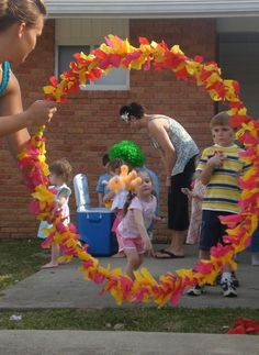 """A hoola hoop with red/yellow crepe paper knotted around it acts as a """"ring of fire"""" - have children throw a lion beanie baby through the hoop for a prize"""