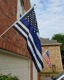 Homeowner told to remove noxious & offensive pro-police flag