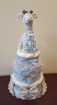 Let me create a special gift or centerpiece for your baby shower, wedding shower, or house warming. Torta Baby Shower, Baby Shower Diapers, Shower Cakes, Baby Nappy Cakes, Diaper Cake Boy, Diaper Cakes For Boys, Baby Shower Giraffe, Grey Baby Shower, Baby Shower Crafts