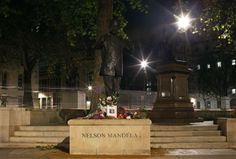 Flowers and tributes are left on the Nelson Mandela statue on Parliament Square in London