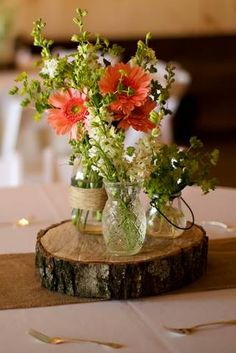 Rustic wedding centerpiece idea: arranging forks around it in a circle is kind of neat. Could do spoons instead.