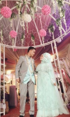 the groom and the bride! georgeus hijab and wedding dress. I love the colour