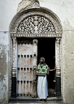 Zanzibar.  Veiled woman in front of a door in Stone Town, Zanzibar, Tanzania by Eric Lafforgue, via Flickr » Beautiful pins @Michelle Price! Thanks for coming into #PinUpLive tonight!